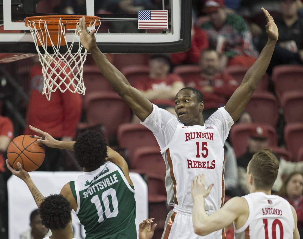 UNLV Rebels forward Cheickna Dembele (15) extends to block the shot of Eastern Michigan Eagles ...