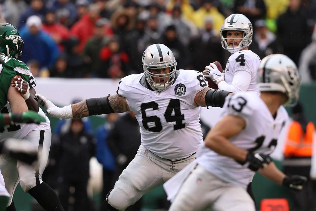 Oakland Raiders offensive guard Richie Incognito (64) blocks as quarterback Derek Carr (4) look ...