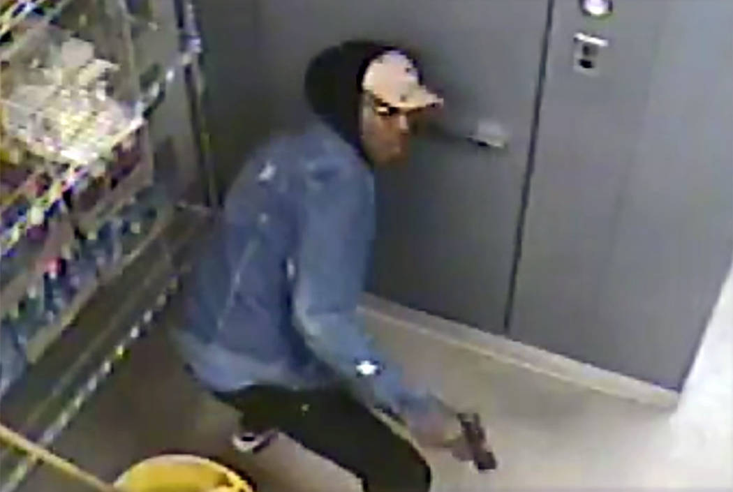 Las Vegas police are searching for a man who robbed a business at gunpoint in the 3000 block of ...