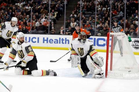 Vegas Golden Knights goaltender Malcolm Subban, right, gives up a goal on a shot from Anaheim D ...