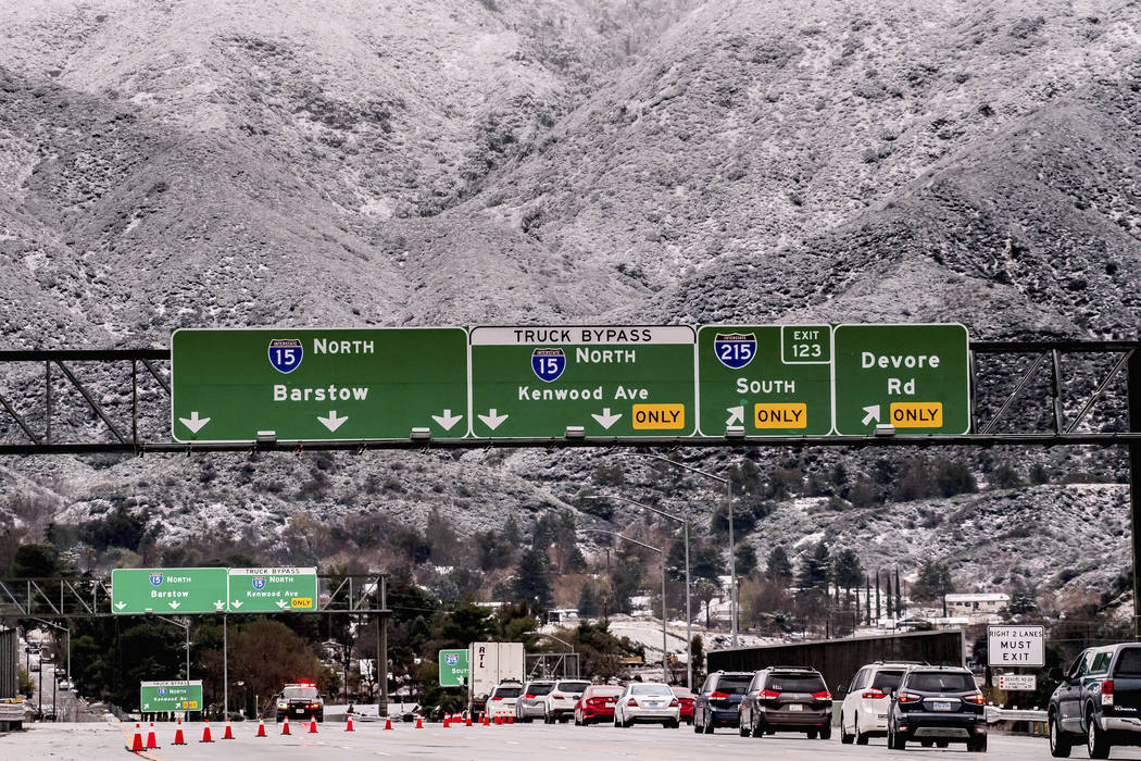 Vehicles are diverted off the northbound 15 Freeway to Kenwood Ave. on-ramp as Cajon Pass is sh ...