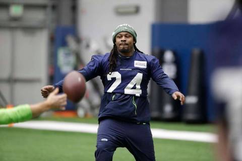 Seattle Seahawks running back Marshawn Lynch warms up for NFL football practice, Friday, Dec. 2 ...