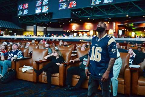 People watch Super Bowl LIII at the Westgate Superbook in Las Vegas in Las Vegas, Sunday, Feb. ...