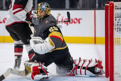 Vegas Golden Knights goaltender Marc-Andre Fleury (29) stops a power-play shot on goal from the ...