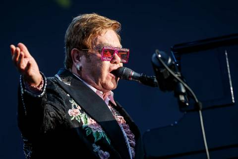 "British singer Elton John performs on the stage of the ""stade de la Saussaz"" during h ..."