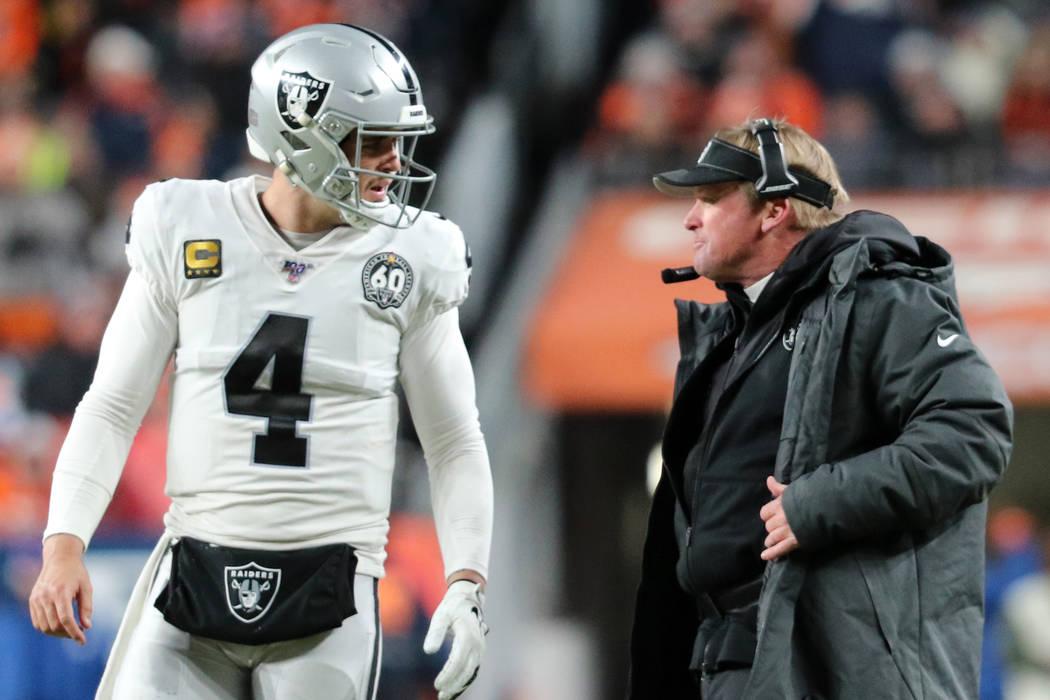 Oakland Raiders quarterback Derek Carr (4) and head coach Jon Gruden discuss a play call during ...