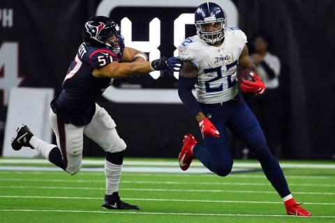 Tennessee Titans running back Derrick Henry (22) breaks away from Houston Texans outside lineba ...