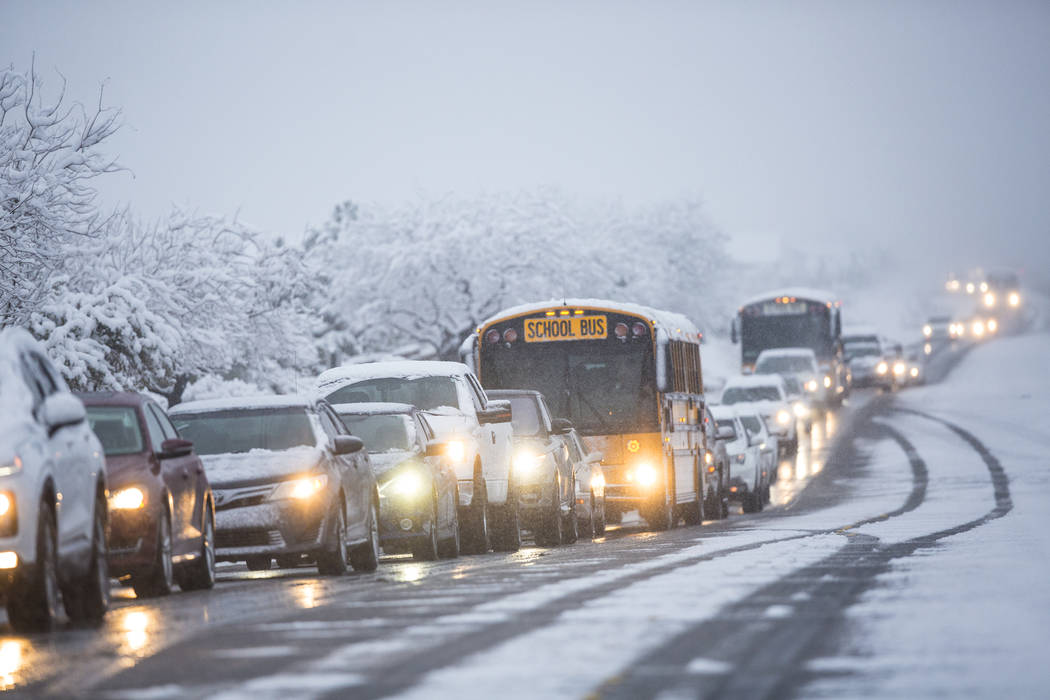 Traffic is backed up in heavy snow near Centennial High School on Thursday, Feb. 21, 2019, in L ...