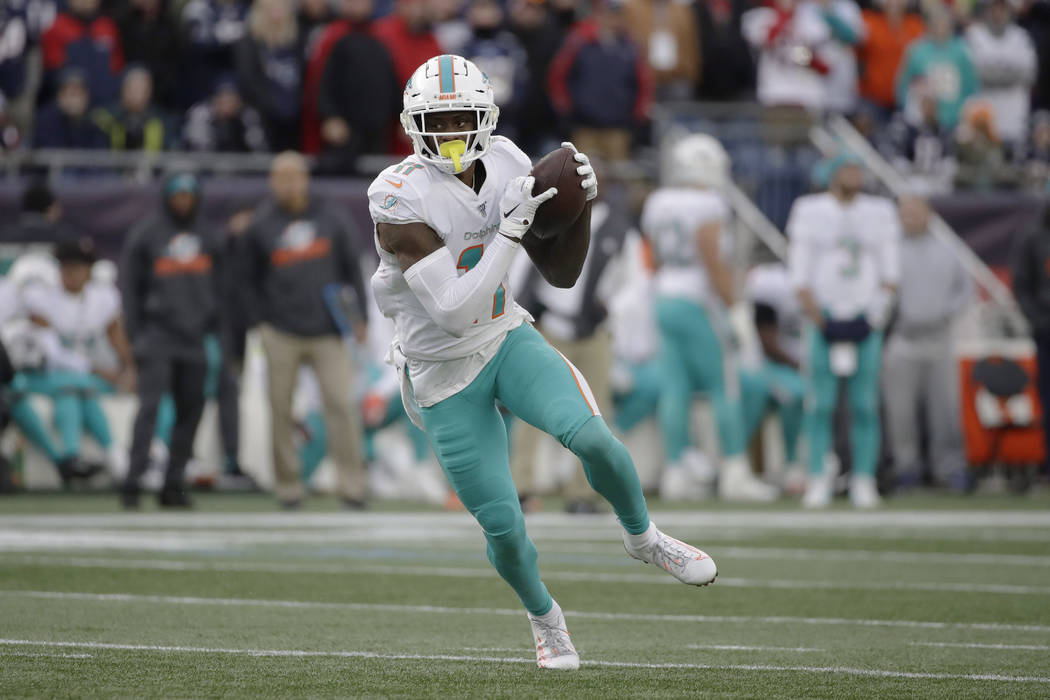 Miami Dolphins wide receiver DeVante Parker runs after catching a pass in the second half of an ...