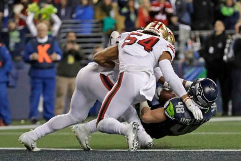 Seattle Seahawks tight end Jacob Hollister (48) is stopped just short of the goal line by San F ...
