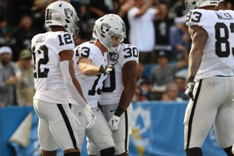 Oakland Raiders wide receiver Hunter Renfrow (13) celebrates his touchdown with wide receiver Z ...