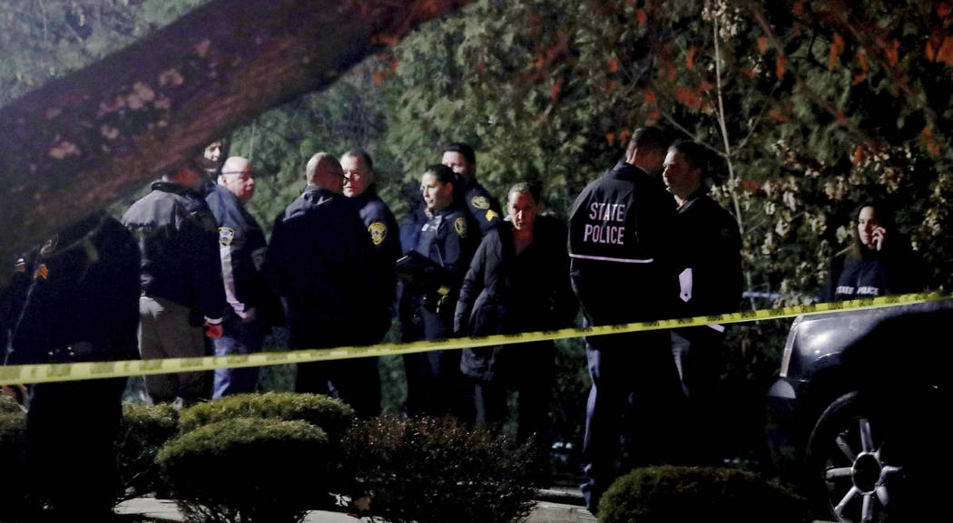 Police gather outside a residence in Monsey, N.Y., early Sunday, Dec. 29, 2019, following a sta ...