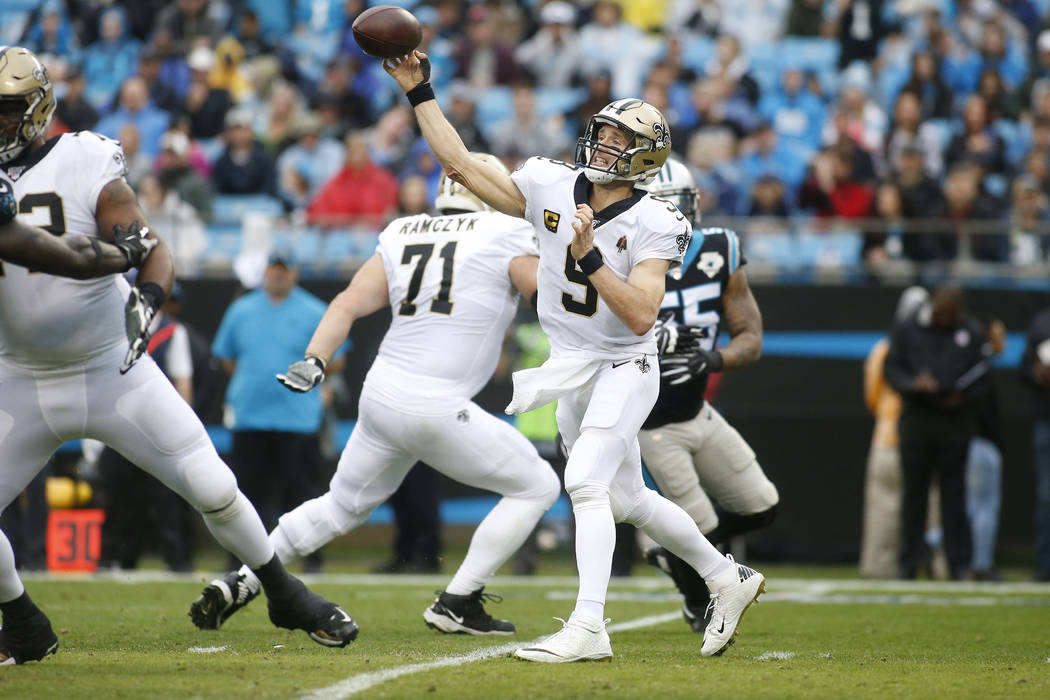 New Orleans Saints quarterback Drew Brees (9) passes against the Carolina Panthers during the f ...