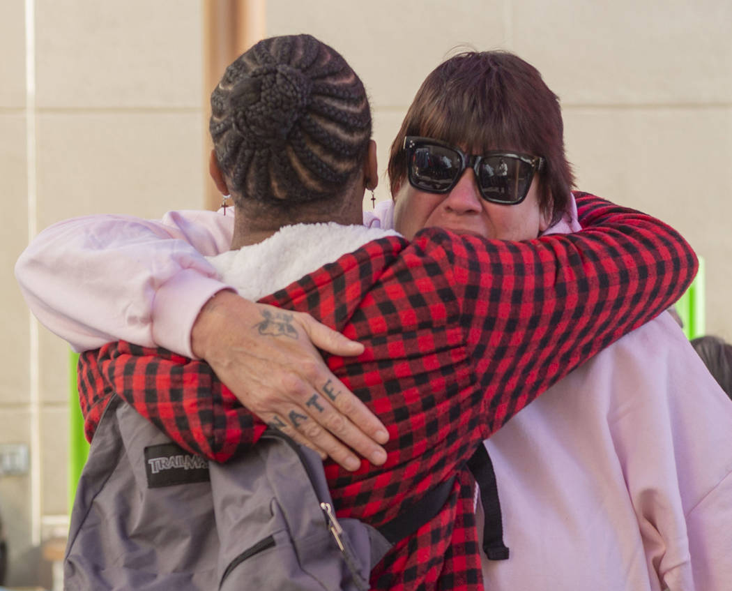 Alpine Motel residents Timothy Henry, left, and a tearful Sandra Jones, comfort one another dur ...