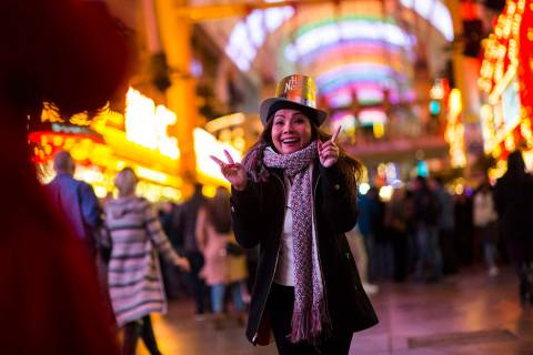 Tammy Dinh of San Diego, Calif., poses for a photo as New Year's Eve revelers gather at the Fre ...
