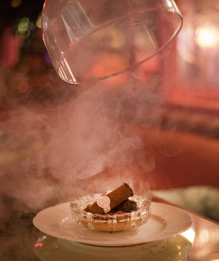 The Cigar, an edible chocolate and hazelnut cigar showpiece that arrive hickory-smoked under a ...