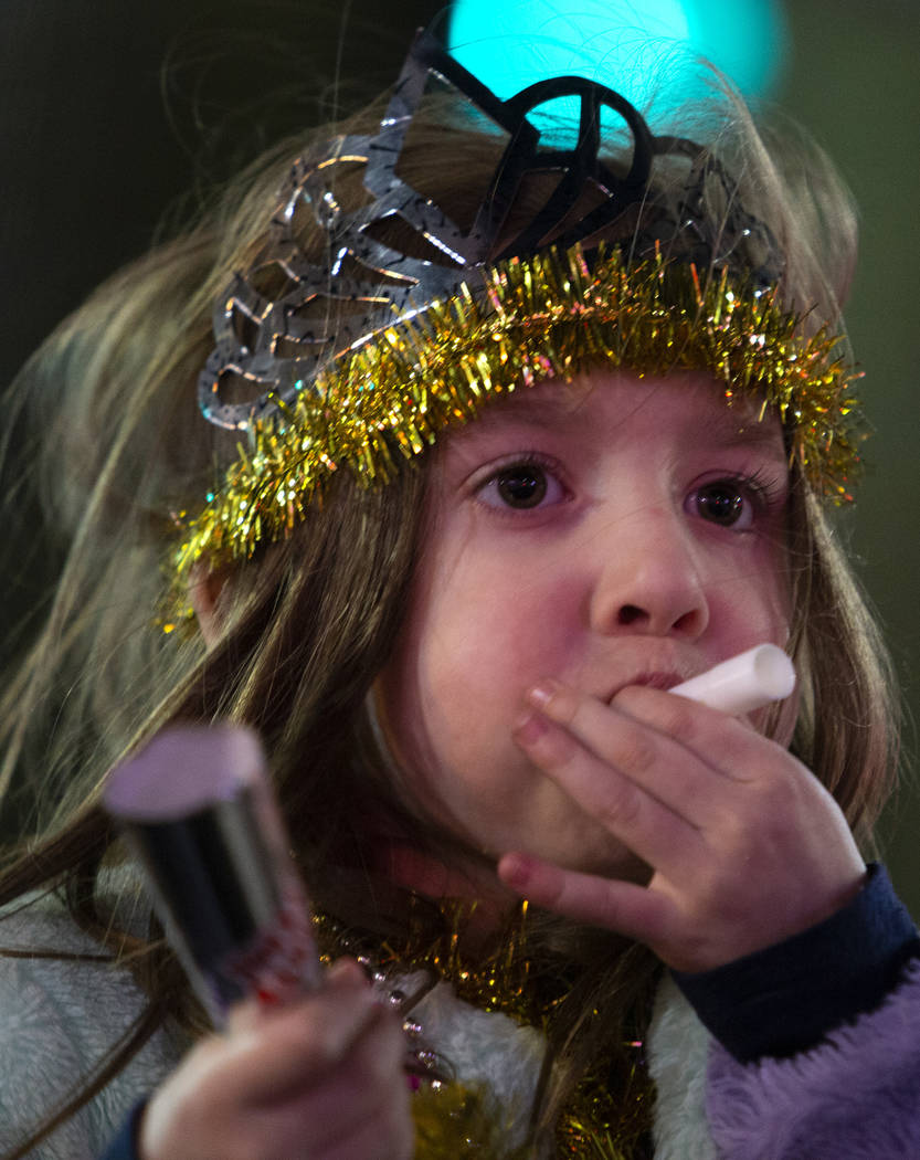 A girl blows a New Year's Eve kazoo on the Strip on Wednesday, Jan. 1, 2020, in Las Vegas. (Ell ...