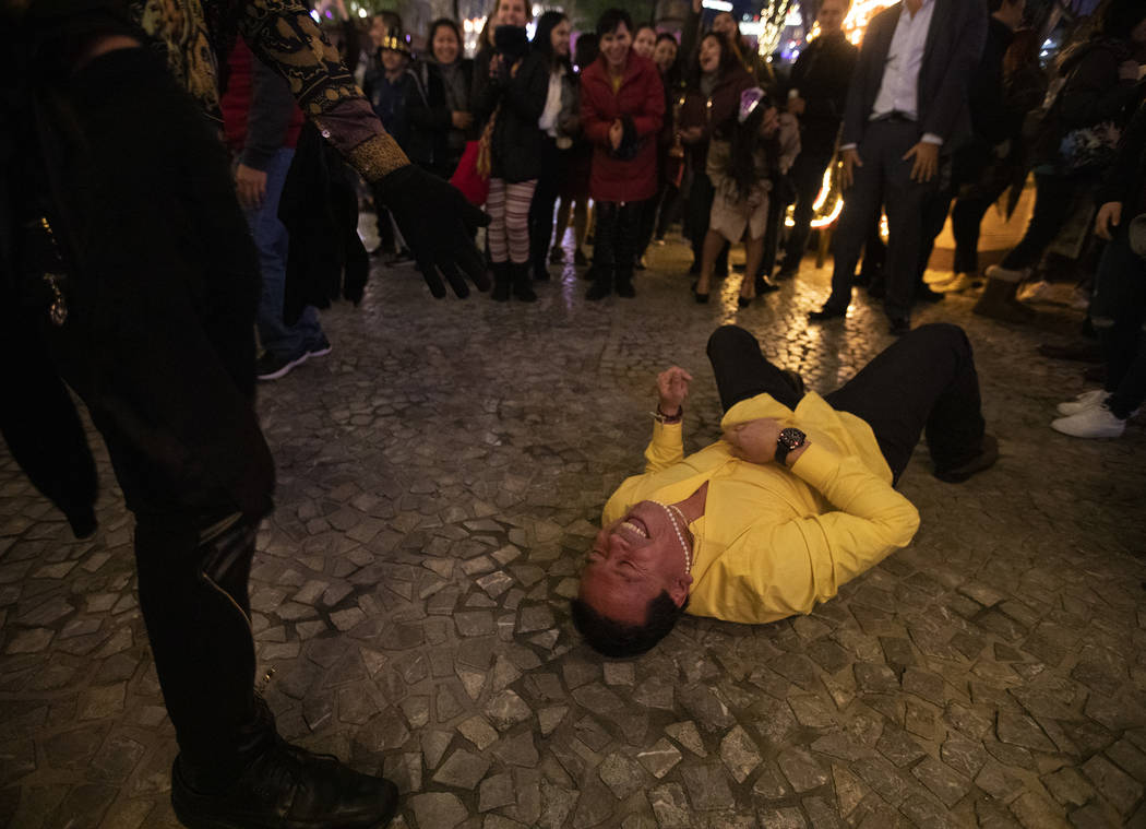 German Moreno of California lays on the pavement after failing at the worm in the center of a d ...