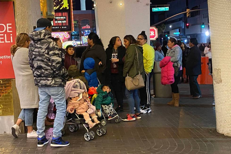 Families with strollers set up shop on Las Vegas Boulevard hoping to watch New Year's fireworks ...