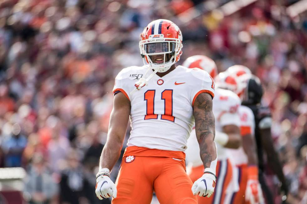 FILE - In this Nov. 30, 2019, file photo, Clemson linebacker Isaiah Simmons (11) celebrates a s ...