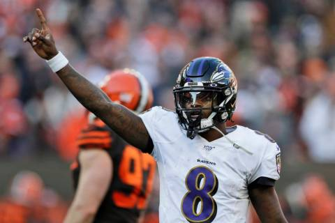 Baltimore Ravens quarterback Lamar Jackson (8) gives a signal during the second half of an NFL ...