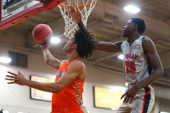 Bishop Gorman's Isaiah Cottrell goes to the basket in front of Findlay Prep's Alex Tchikou (35) ...