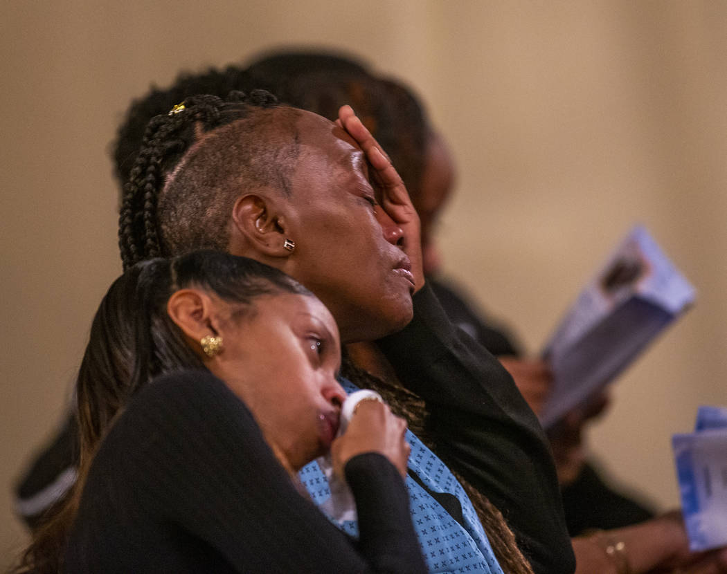Family members become emotional during a funeral service for Don Bennett, a maintenance man and ...