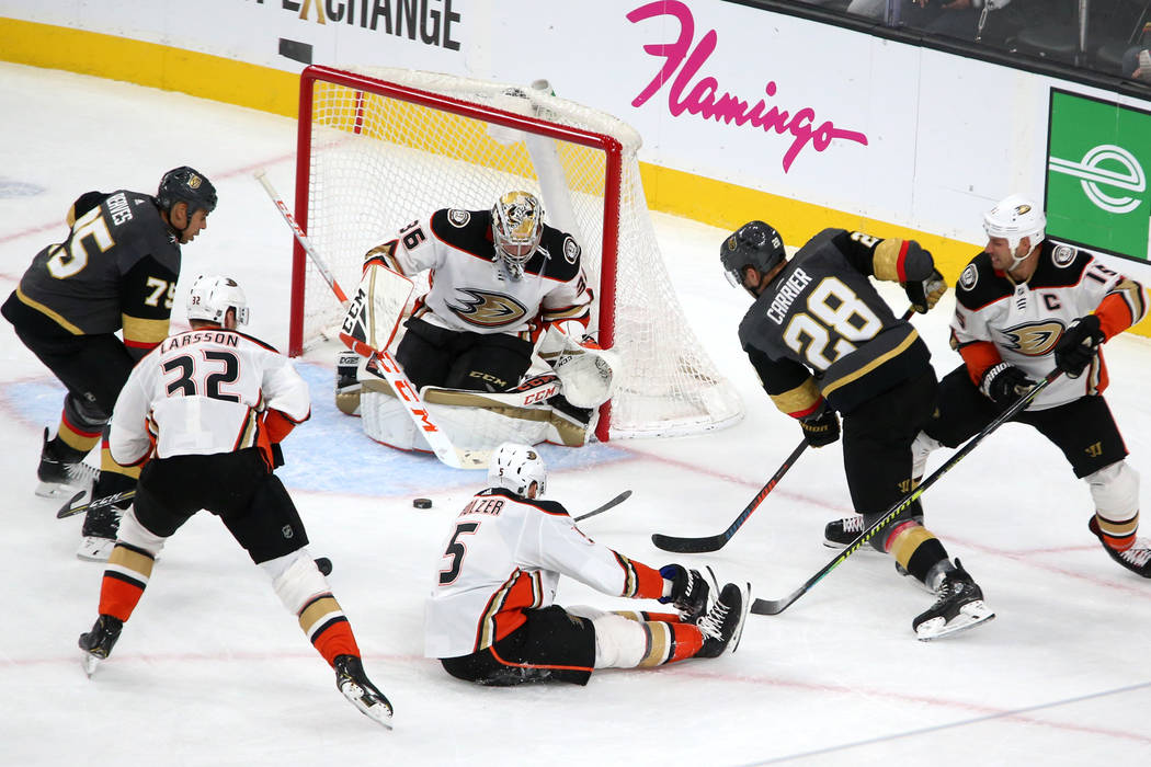 Vegas Golden Knights right wing Ryan Reaves (75) and left wing William Carrier (28) battle for ...