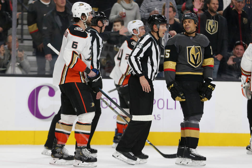Vegas Golden Knights right wing Ryan Reaves (75) is moved away from Anaheim Ducks defenseman Er ...