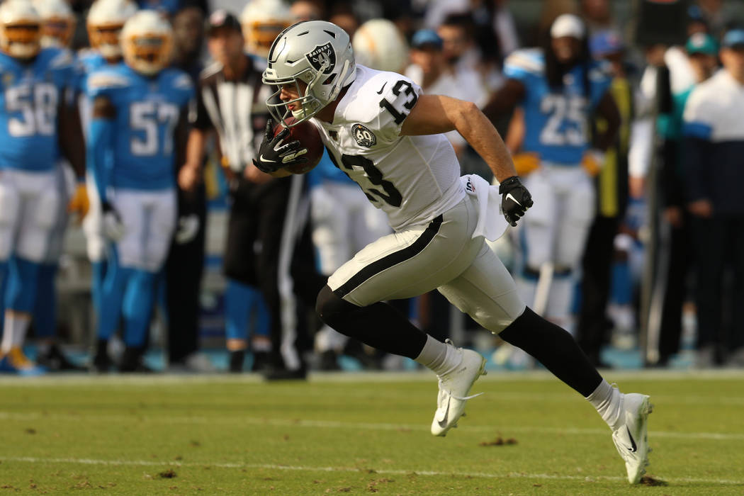 Oakland Raiders wide receiver Hunter Renfrow (13) breaks loose and heads to the end zone during ...