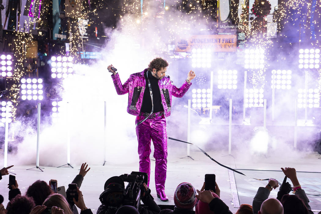 Post Malone performs at the Times Square New Year's Eve celebration on Tuesday, Dec. 31, 2019, ...