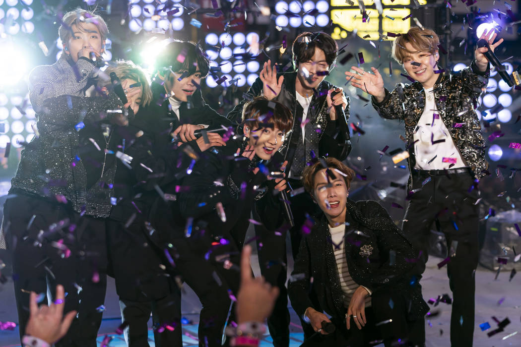 BTS perform at the Times Square New Year's Eve celebration on Tuesday, Dec. 31, 2019, in New Yo ...