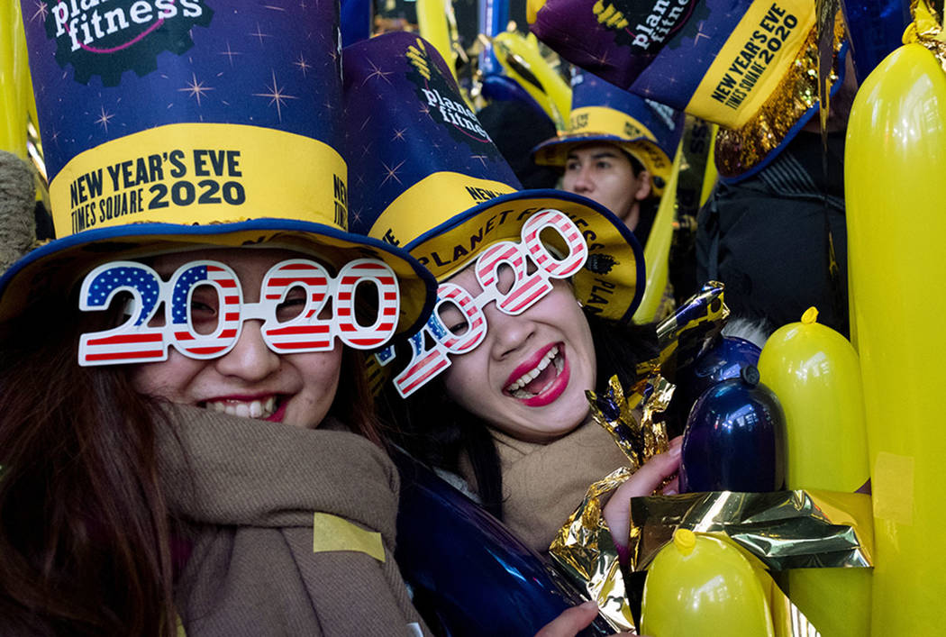 Revelers take part in New Year celebrations on Times Square in New York, Tuesday, Dec. 31, 2019 ...