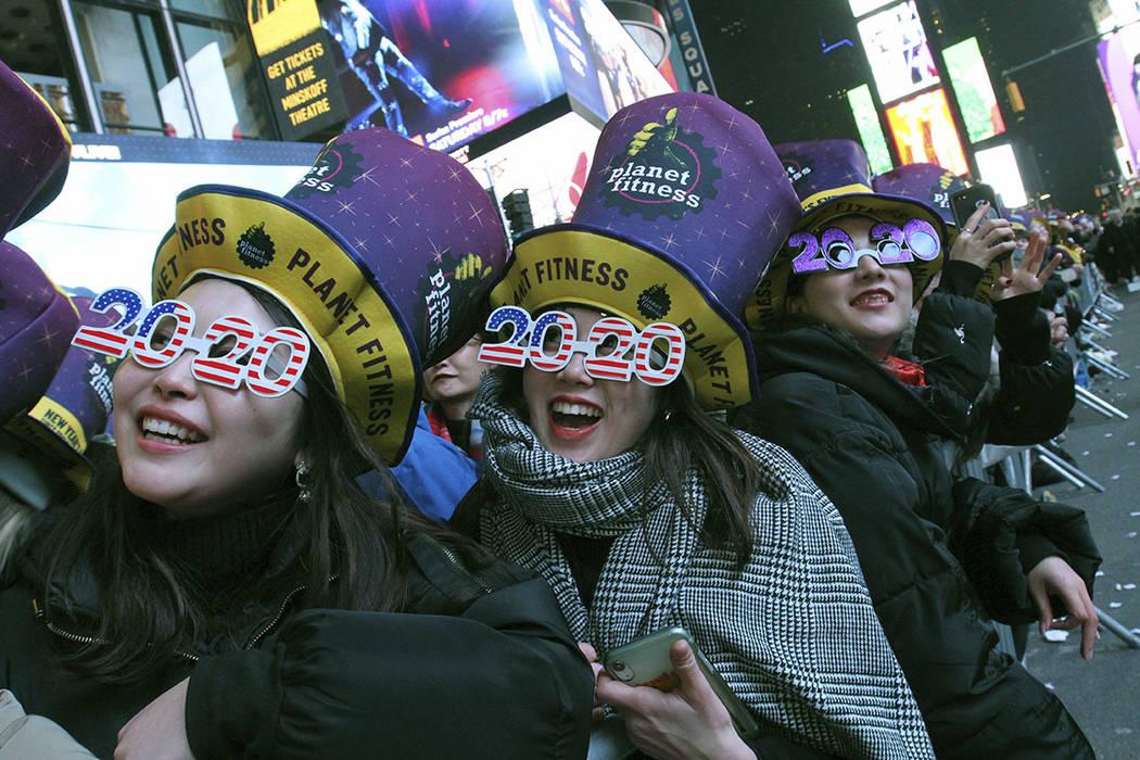 Revelers, including Natsumi Ishikawa, left, and Minori Kondo, second from left, both from Nagoy ...