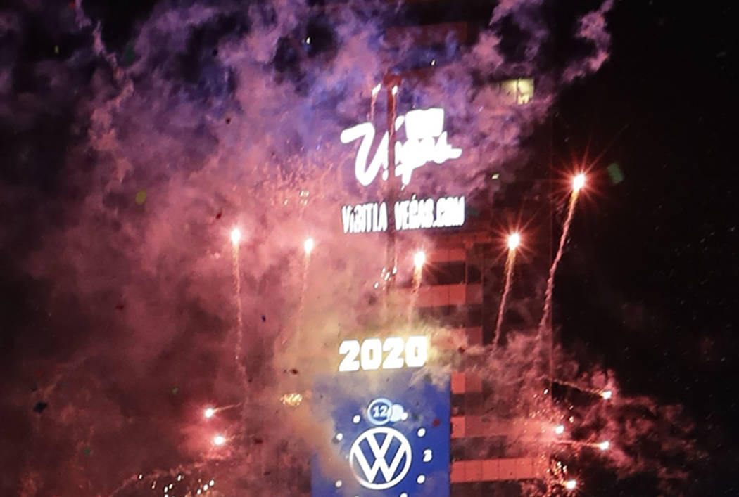 Confetti drops over the crowd as the clock strikes midnight during the New Year's celebration a ...