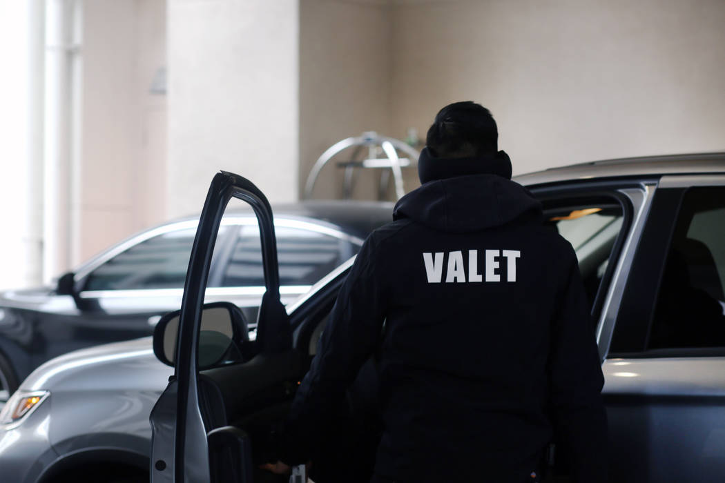 A valet runner takes care of a guest with free valet parking at the Sahara Las Vegas on Friday, ...