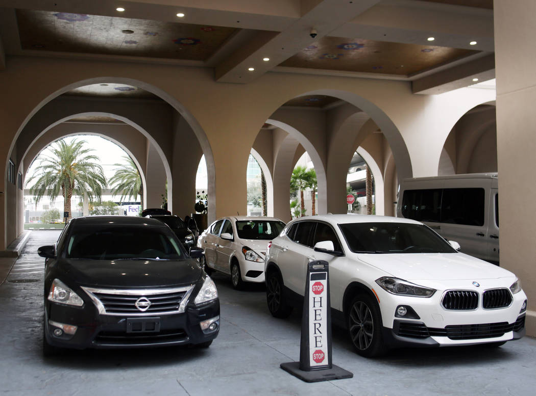 Vehicles are dropped off for the free valet parking at the Sahara Las Vegas on Friday, Dec. 20, ...