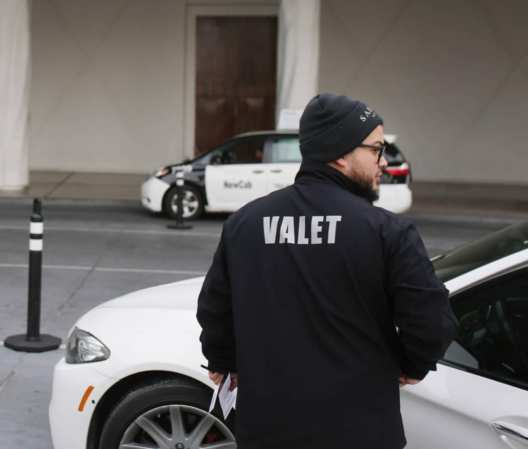 Valet runner Joel Tejada takes care of a guest at the Sahara Las Vegas in Las Vegas on Friday, ...