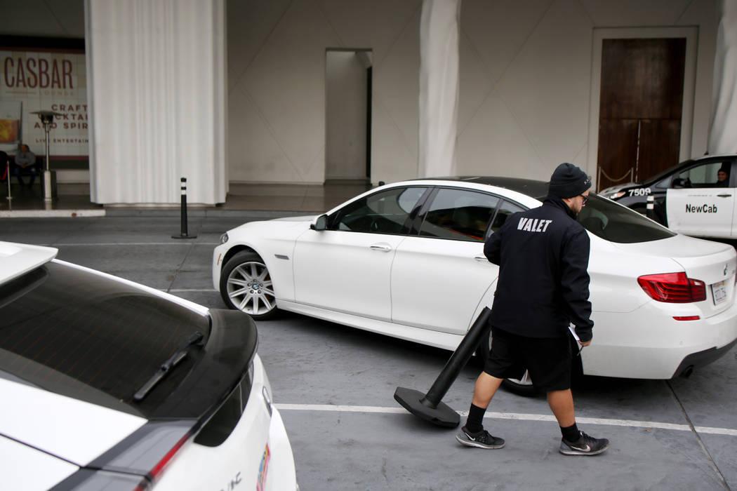 Valet runner Joel Tejada helps a guest after retrieving their vehicle at the Sahara Las Vegas o ...