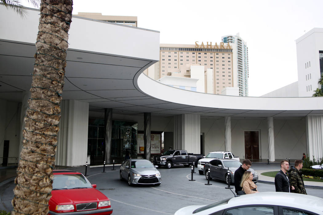 Individuals come and go at an entrance where there is free valet parking available at the Sahar ...