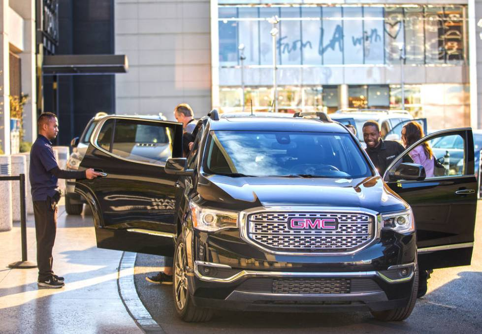 Mark Reolegio, left, and Desean Frazier valet cars outside The Capital Grille on Wednesday, Feb ...