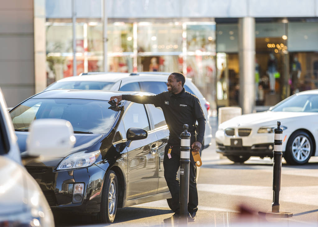 Desean Frazier valets cars outside The Capital Grille on Wednesday, Feb. 27, 2019, at Fashion S ...
