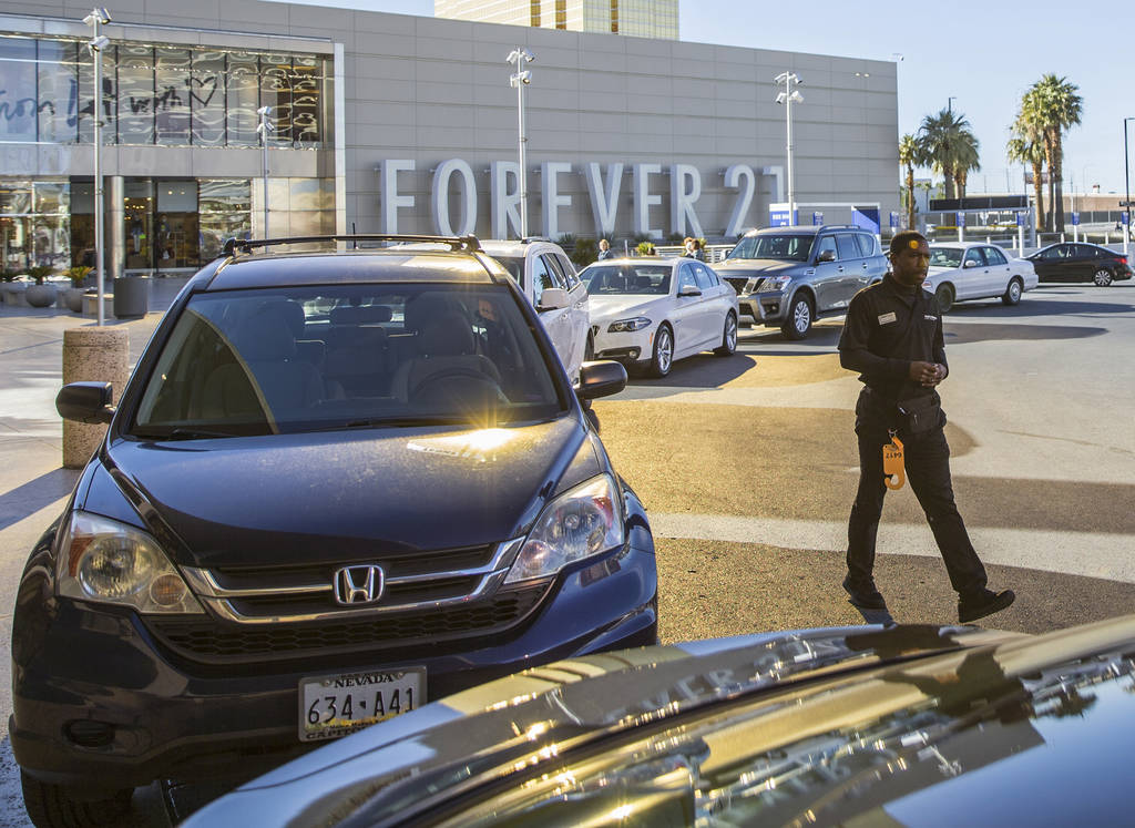 Desean Frazier, right, valets cars outside The Capital Grille on Wednesday, Feb. 27, 2019, at F ...