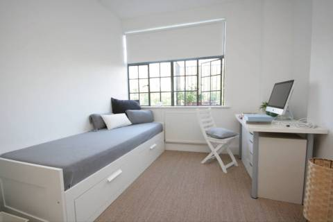 This office can transform into a guest room when needed. (Houzz)