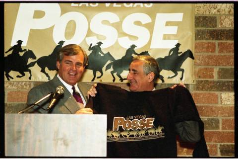 Former National Football League and UNLV football coach Ron Meyer (left) officially joins the L ...