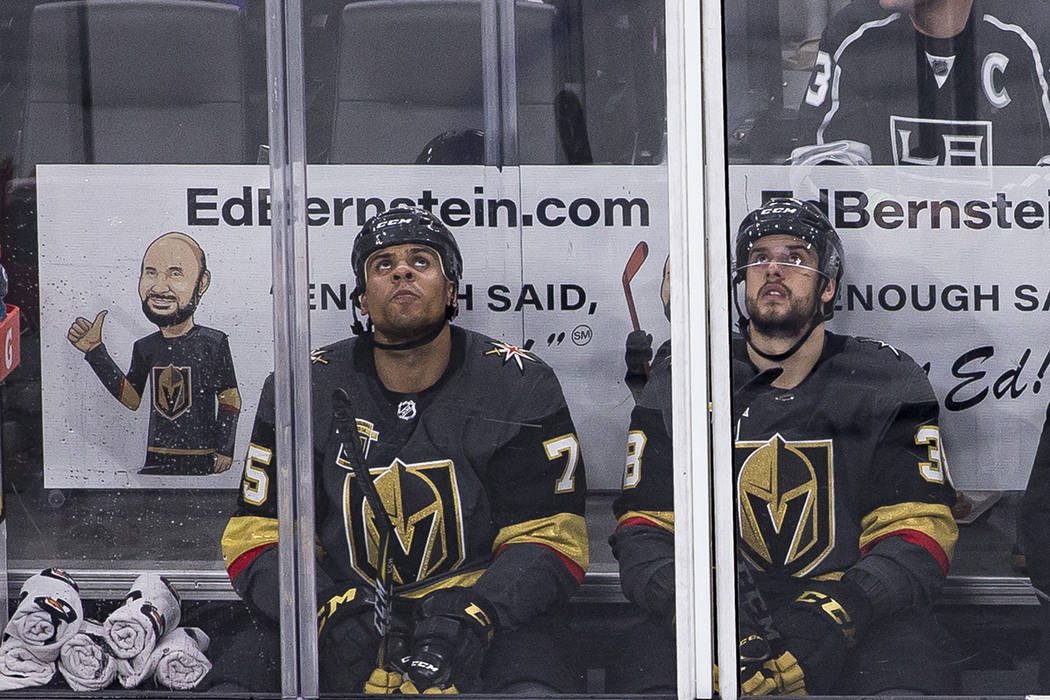 Vegas Golden Knights Ryan Reaves (75) and Tomas Hyka (38) look up from the penalty box during a ...