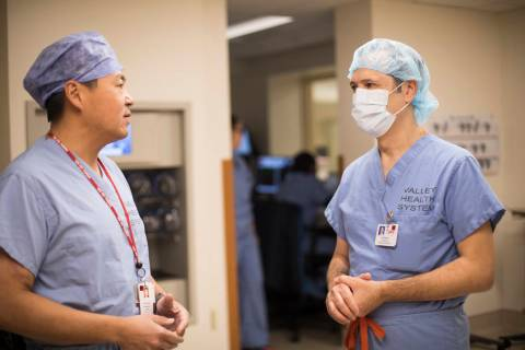 "Dr. Eddy Luh, left, speaks with Dr. Oussama ""Sam"" Hajal, right, who worked for mo ..."
