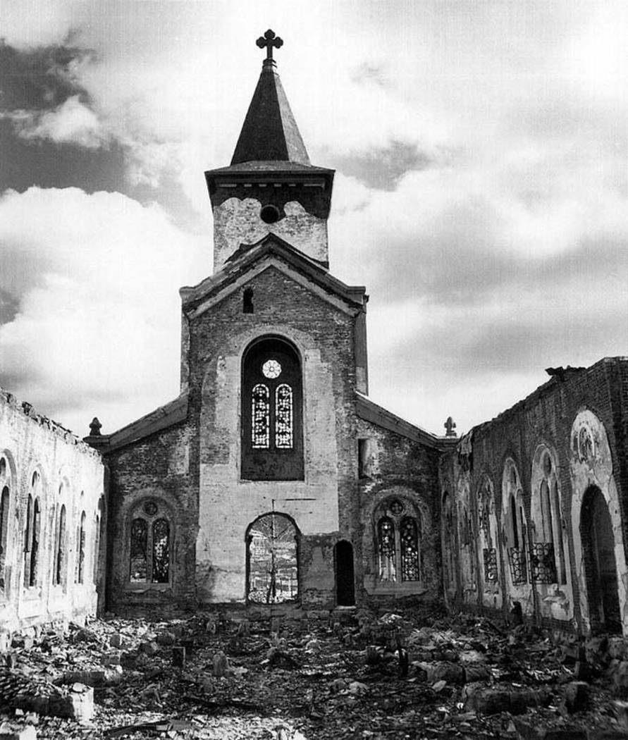A Christian church, many of it's stained glass windows still intact, is shown in this photograp ...