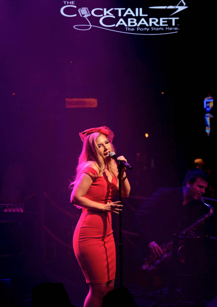 """Maren Wade takes center stage during the opening night of the musical review """"The Cocktail Caba ..."""