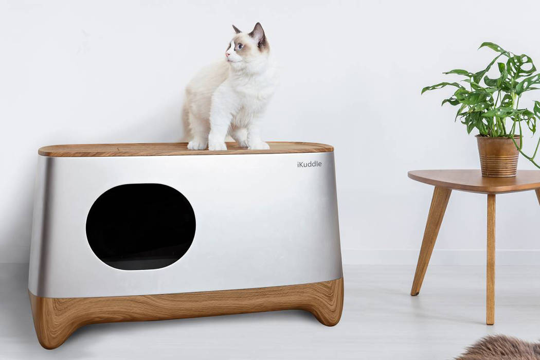 iKuddle's app-controlled Smart Litter Box self cleans, automatically packages litter, links t ...